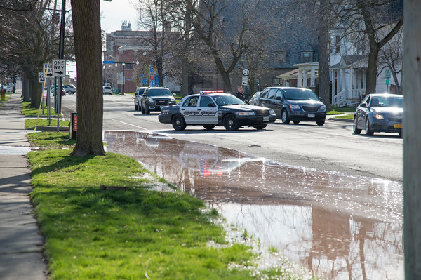 JOED VIERA/STAFF PHOTOGRAPHER- Lockport, NY-Police arrive to the scene of a water main break on East Avenue at McCollum Street.
