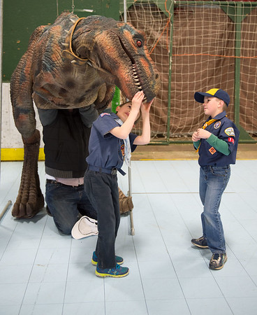 JOED VIERA/STAFF PHOTOGRAPHER-Lockport, NY-Rapids Fire Hall Cub Scout Pack 3071's Tanner Gurnett and Linus Keleher check out a dinosaur suit at the Kenan Arena.