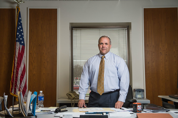 JOED VIERA/STAFF PHOTOGRAPHER- Lockport, NY-Rick Updegrove in his office.
