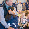 JOED VIERA/STAFF PHOTOGRAPHER- Lockport, NY-Tom Cowan hugs his granddaughter<br /> Kaitlyn Griffin 12 at the end of mass at DeSales Catholic School.