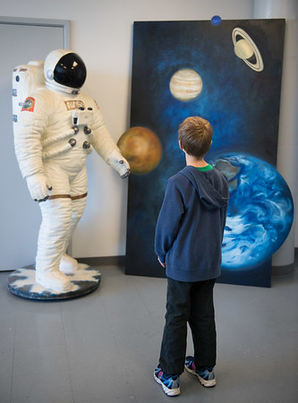 JOED VIERA/STAFF PHOTOGRAPHER- Lockport, NY-Nick Waz looks at a model and painting at the Challenger Learning Center.