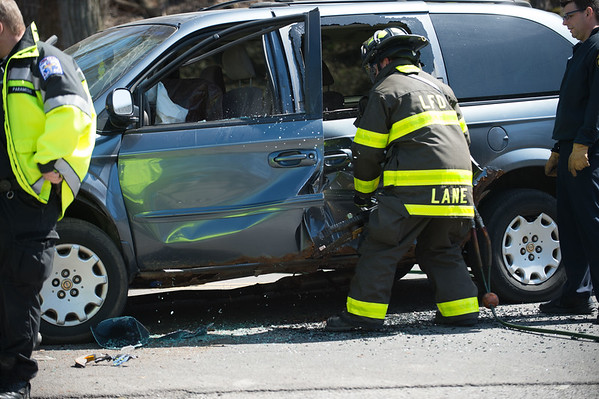 JOED VIERA/STAFF PHOTOGRAPHER- Lockport, NY-A Lockport City Firefighter uses the jaws of life on a minivan at the scene of a two vehicle head on collision on Market Street.