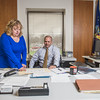 JOED VIERA/STAFF PHOTOGRAPHER- Lockport, NY-Lisa Serianne works with Rick Updegrove in his office.
