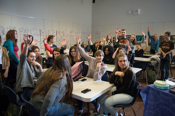 JOED VIERA/STAFF PHOTOGRAPHER- Lockport, NY-Students visiting Lockport High School from France raise their hands at a farewell reception in the school's Art Gallery.