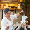 JOED VIERA/STAFF PHOTOGRAPHER- Lockport, NY-Kathy Qualiana practices Reiki on a client at her home.