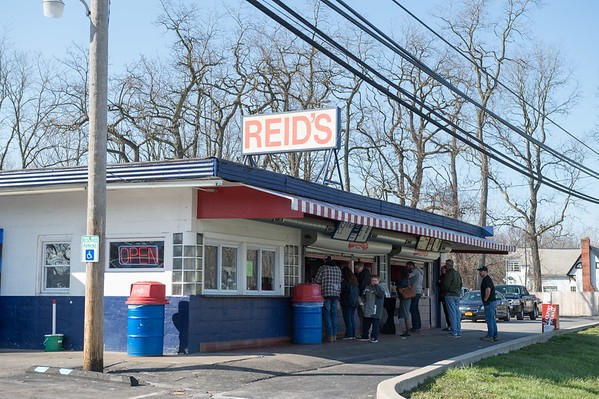 JOED VIERA/STAFF PHOTOGRAPHER- Lockport, NY-Patrons line up food at Reid's.