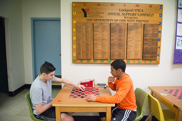 JOED VIERA/STAFF PHOTOGRAPHER- Lockport, NY-Xavier Maclin and Isiah Johnson play a game of checkers at the YMCA.