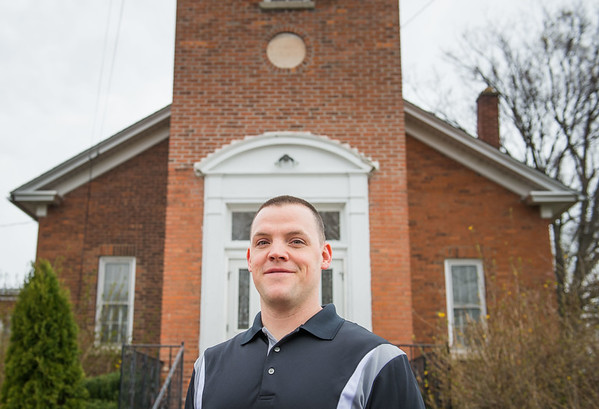 JOED VIERA/STAFF PHOTOGRAPHER-Wrights Corners, NY-Rev. Tommy  Detschner stands at his new church Saint Family Ministries on Ridge Road.