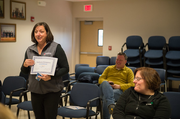 JOED VIERA/STAFF PHOTOGRAPHER- Pendleton, NY-Shirley Carnall presents attendees with a certificate a Red Cross preparedness meeting at Pendleton Town Hall.