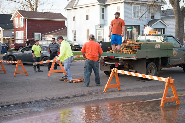 JOED VIERA/STAFF PHOTOGRAPHER- Lockport, NY-Crews work at the scene of a water main break on East Avenue at McCollum Street.