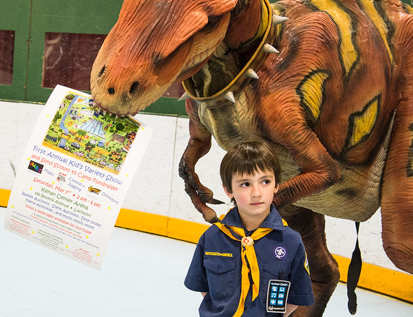 JOED VIERA/STAFF PHOTOGRAPHER-Lockport, NY-Rapids Fire Hall 3071 Cub Scout  James McQuestion,  stands under a dinosaur suit at the Kenan Arena.