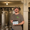 JOED VIERA/STAFF PHOTOGRAPHER- Wilson, NY-Matt Redpath shows off cans of Niagara Lager at Woodcock Brothers Brewery.