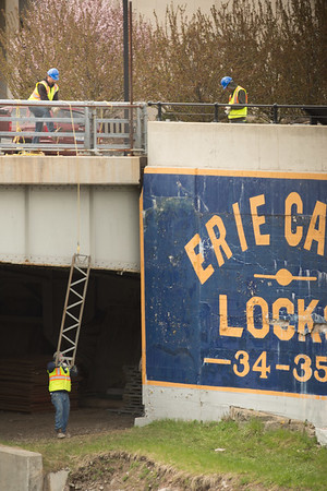 JOED VIERA/STAFF PHOTOGRAPHER- Lockport, NY-DOT workers lower components for a platform.