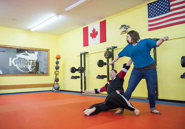 JOED VIERA/STAFF PHOTOGRAPHER- Lockport, NY-Melissa Miller practices a self-defense technique on Ken Meier at Karate Ken's.