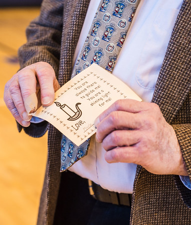 JOED VIERA/STAFF PHOTOGRAPHER- Lockport, NY-Roy Crocker holds a card he recieved from his grandson, Mark Crocker, 14, at DeSales Catholic School.