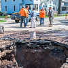 JOED VIERA/STAFF PHOTOGRAPHER- Lockport, NY-Lockport City Engineer Rolando Moreno speaks with crews repairing a water main break on East Avenue at McCollum Street.