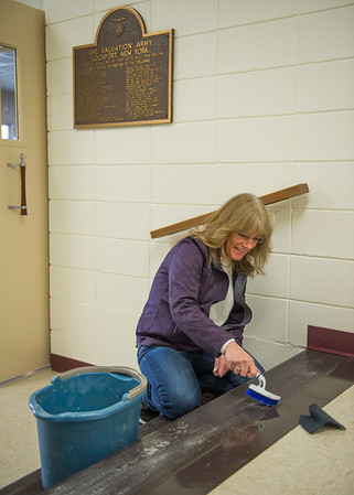 JOED VIERA/STAFF PHOTOGRAPHER- Lockport, NY-Rita Hendel cleans up the Salvation Army on Cottage Street in preparation for their open house on Saturday.