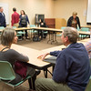 JOED VIERA/STAFF PHOTOGRAPHER- Lockport, NY-Samara Albuquerque and Steve Cotten chat during a Rotaract meeting at the Lockport Public Library.