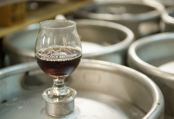 JOED VIERA/STAFF PHOTOGRAPHER- Wilson, NY-A glass of Barrel-Aged Belgian Rye sits on a keg at Woodcock Brothers Brewery.