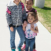 JOED VIERA/STAFF PHOTOGRAPHER- Lockport, NY-Sisters Ava 8, left, Aaliya 6, and Abigail Holloway 2 as they leave Anna Merritt Elementary with their mother Amy Holloway at the end of the school day.
