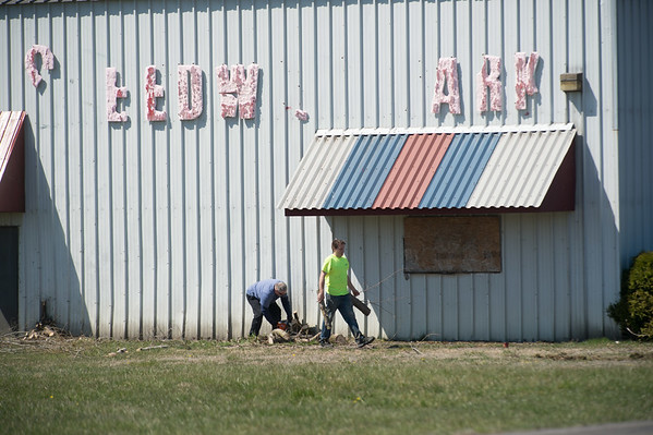 JOED VIERA/STAFF PHOTOGRAPHER- Lockport, NY-Lockport City School District workers clean up the grounds around their new storage facility at the former Speedway park building on Corinthia St.