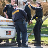 JOED VIERA/STAFF PHOTOGRAPHER- Lockport, NY-A suspect in a robbery that occured on Saxton Street and Lagrange Street is searched by Lockport Police and Niagara County Sheriffs Deputies.