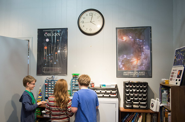 JOED VIERA/STAFF PHOTOGRAPHER- Lockport, NY-Nick Waz, Donovan Monaco and  Trever LeFeve grabs lego pieces for a model they are building during Lego League at the Challenger Learning Center.