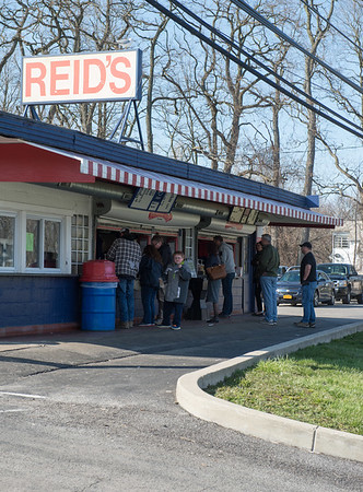 JOED VIERA/STAFF PHOTOGRAPHER- Lockport, NY-Patrons line up food at Reid's.