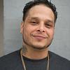 JOED VIERA/STAFF PHOTOGRAPHER- Lockport, NY-Joshua Lopez outside his shop.