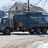 JOED VIERA/STAFF PHOTOGRAPHER- Lockport, NY-A garbage truck picks up trash on Harrison Avenue.