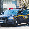 JOED VIERA/STAFF PHOTOGRAPHER- Lockport, NY-A suspect in a robbery that occured on Saxton Street and Lagrange Street is put into a NY State Trooper cruiser.