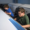JOED VIERA/STAFF PHOTOGRAPHER- Lockport, NY-Trever LeFeve and Bill Bernard play in the mission control room at the Challenger Learning Center.