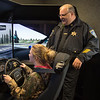 JOED VIERA/STAFF PHOTOGRAPHER- Pendleton, NY-Deputy Joseph Flagler guides Taylor Heckman as she tries out Niagara County Sheriffs Department's new driving simulator at Starpoint High School.