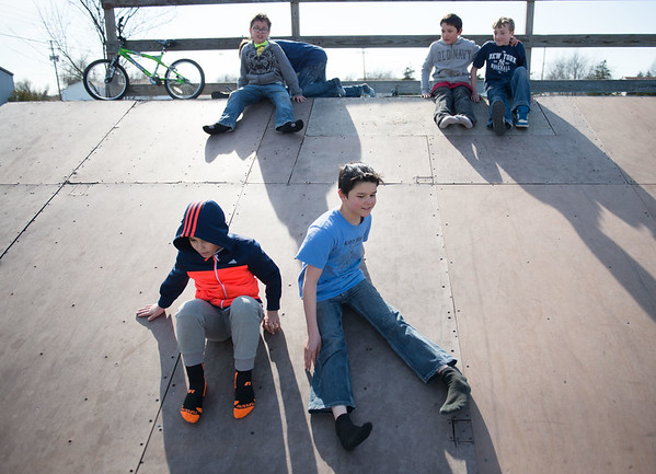 JOED VIERA/STAFF PHOTOGRAPHER- Lockport, NY-Kids slide down one of the ramps at Lockport's Skate Park.