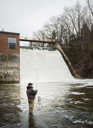 JOED VIERA/STAFF PHOTOGRAPHER- Burt, NY-Paul Povanda hopes to catch some Steelhead at Fisherman's Park during his trip from Port Chester NY.