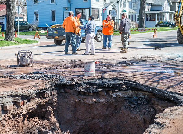 JOED VIERA/STAFF PHOTOGRAPHER- Lockport, NY-Lockport City Engineer Rolando Moreno speaks with crews repairing a water main break on East Avenue at McCollum Street.