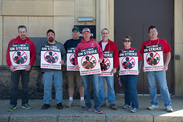 JOED VIERA/STAFF PHOTOGRAPHER- Lockport, NY-Nick Piscicelli, Matt Niezgoda, Richie Landsheft, CWA Vice President Phil Rudnick, Pete Donovan, Mary Trautwien and Duane Duxbury strike against Verizon on Walnut Street.
