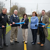 JOED VIERA/STAFF PHOTOGRAPHER- Lockport, NY-Director of the New York State Canal Corporation Brian U. Stratton, Town of Lockport Supervisor Mark Crocker, New York State Lt. Gov. Kathy Hochul, Lockport Mayor Anne McCaffrey and  New York Senator Robert Ortt. cut a ribbon celebrating the completion of Lockport's section of the Erie Canalway Trail.