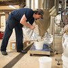 JOED VIERA/STAFF PHOTOGRAPHER- Wilson, NY-Matt Redpath measures out ingredients at Woodcock Brothers Brewery.
