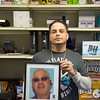 JOED VIERA/STAFF PHOTOGRAPHER- Lockport, NY-Joshua Lopez holds a picture of his late financier Raymond Steiner inside his shop.