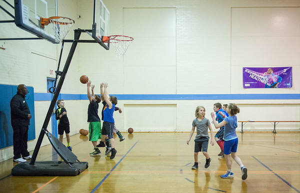JOED VIERA/STAFF PHOTOGRAPHER- Lockport, NY-Kids learn basketball plays at the YMCA.