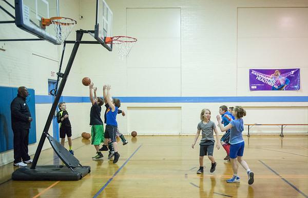 JOED VIERA/STAFF PHOTOGRAPHER- Lockport, NY-Kids learn basketball plays at the YMCA.