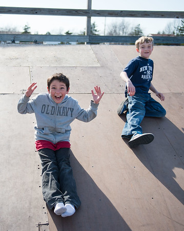 JOED VIERA/STAFF PHOTOGRAPHER- Lockport, NY-Travis Salas 10 and David Soulvie 10 slide down one of the ramps at Lockport's Skate Park.