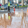 JOED VIERA/STAFF PHOTOGRAPHER- Lockport, NY-Water floods the scene of a water main break on East Avenue at McCollum Street.