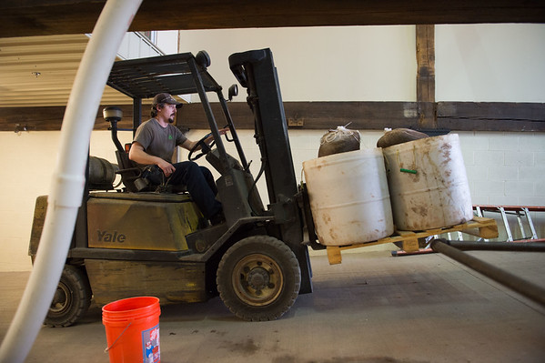 JOED VIERA/STAFF PHOTOGRAPHER- Wilson, NY-Matt Redpath disposes of used  ingredients at Woodcock Brothers Brewery.