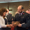 JOED VIERA/STAFF PHOTOGRAPHER- Lockport, NY-Majors Jose and Elsa Jo Santiago present Anne Calos with the Others Award during the Salvation Army's Open House.