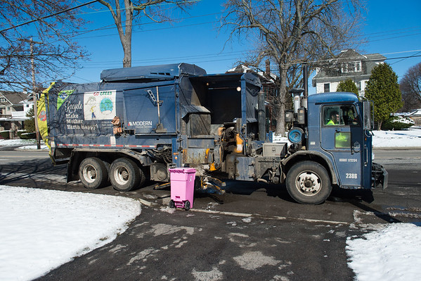 JOED VIERA/STAFF PHOTOGRAPHER- Lockport, NY-A garbage truck picks up trash on East Ave.