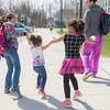 JOED VIERA/STAFF PHOTOGRAPHER- Lockport, NY-Ava 8, left,  and Aaliya Holloway 6 play with their sister Abigail Holloway 2 as they leave Anna Merritt Elementary with their mother Amy Holloway at the end of the school day.