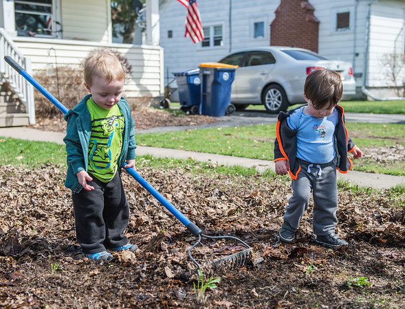 JOED VIERA/STAFF PHOTOGRAPHER- Lockport, NY-Sam Henderson,1 (right) helps Noah Greinern, 1 rake a yard on Prospect Street.