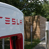 EAST BRUNSWICK, NEW JERSEY - JULY 20, 2016: Close up of Tesla Supercharger with trees in the background at the Joyce Kilmer Service Area on New Jersey Turnpike